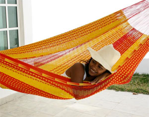 Woman Napping in a Brazilian Hammock and the Benefits of Sleeping in a Hammock