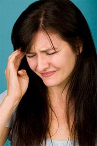 Woman suffering from migraine headache