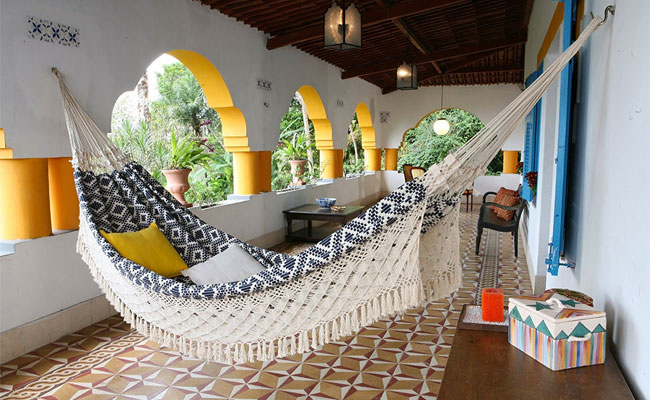 Navy and White Jacquard Hand Woven Hammock on Patio