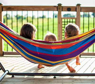 3 Kids Sitting in Hammock